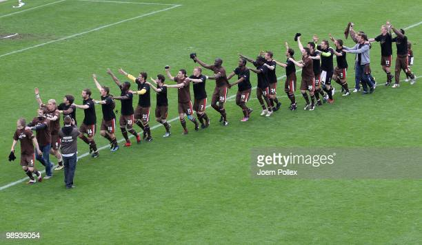 The team of St Pauli celebrate after the Second Bundesliga match between FC St Pauli and SC Paderborn at Millerntor stadium on May 9 2010 in Hamburg...