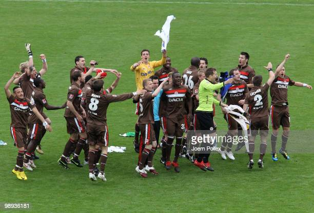 The team of St. Pauli celebrate after the Second Bundesliga match between FC St. Pauli and SC Paderborn at Millerntor stadium on May 9, 2010 in...