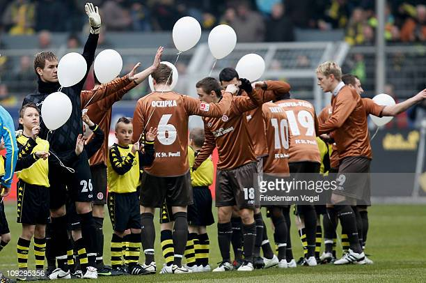 The team of St Pauli lines up with children before the Bundesliga match between Borussia Dortmund and FC St Pauli at Signal Iduna Park on February 19...