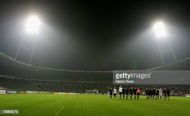 The team of St.Pauli celebrate with the fans after the Third League match between Werder Bremen II and FC St.Pauli at the Weser stadium on April 24,...