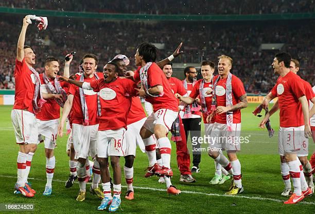 The team of Stuttgart celebrates after winning the DFB Cup Semi Final match between VfB Stuttgart and SC Freiburg at Mercedes-Benz Arena on April 17,...