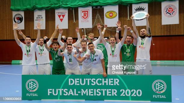 The team of SV Hohenstein-Ernstthal lifts the winning trophy after winning 6-2 the German Futsal Championship Final match between Jahn Regensburg and...
