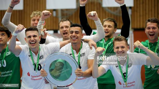 The team of SV Hohenstein-Ernstthal with Valente Fogaca, Francisco de Olivei and Jurij Jeremejev lifts the winning tropher after the German Futsal...
