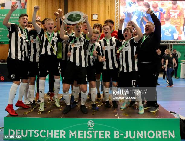 The team of SV Sandhausen 1916 cdelebrates with the trophy after winning the German Futsal Championship of B Juniors at Sporthalle West on March 24...