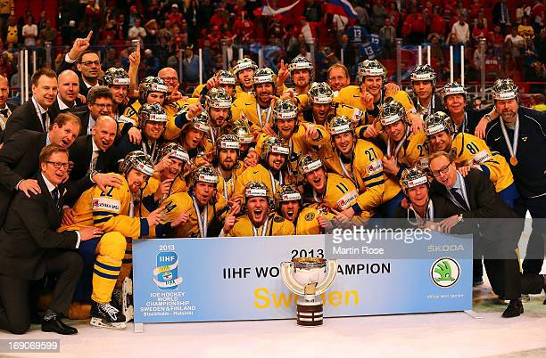 The team of Sweden celebrate after winning the IIHF World Championship final match between Swiss and Sweden at Globen Arena on May 19 2013 in...