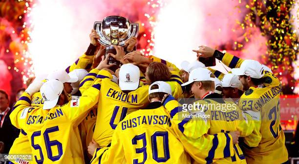 The team of Sweden celebrate winning the gold medal after the 2018 IIHF Ice Hockey World Championship Gold Medal Game game between Sweden and...