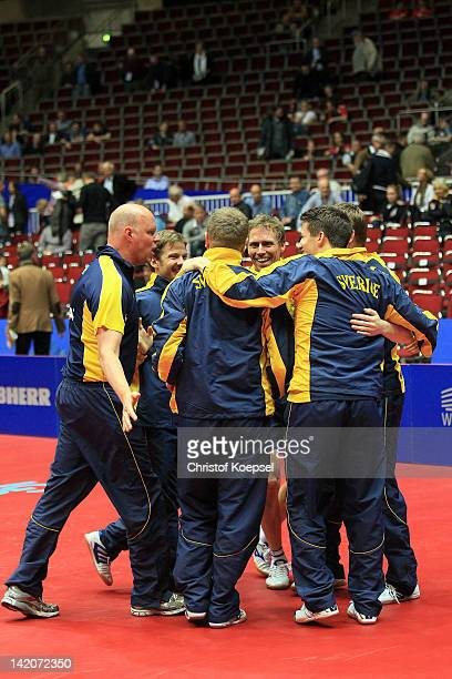 The team of Sweden celebrates after winning 3-0 against Portugal during the LIEBHERR table tennis team world cup 2012 championship division round of...