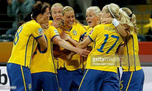 The team of Sweden celebrates Josefine Oeqvist scoring their team's first goal during the FIFA Women's World Cup Semi Final match between Japan and...