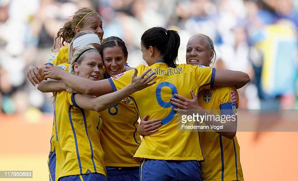 The team of Sweden celebrates scoring the first goal during the FIFA Women's World Cup 2011 Group C match between North Korea and Sweden at FIFA...