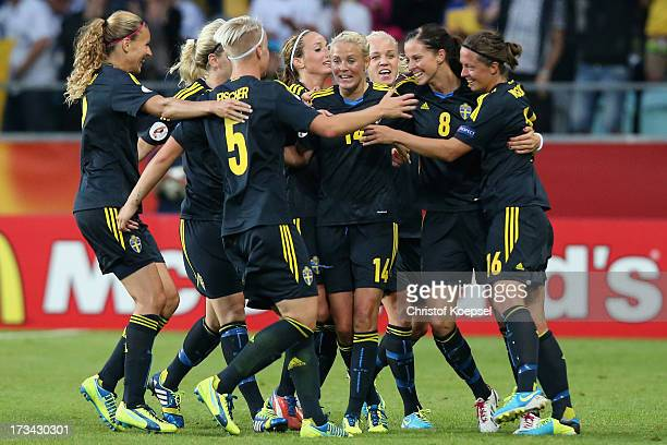 The team of Sweden dances after the forth goal scored by Lotta Schelin during the UEFA Women's EURO 2013 Group A match between Finland and Sweden at...