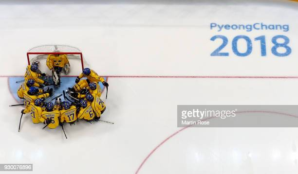 The team of Sweden lines up before the Ice Hockey Preliminary Round Group A game between Canada and Sweden during day one of the PyeongChang 2018...