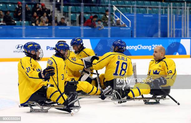 The team of Sweden reacts after the Ice Hockey Preliminary Round Group A game between Canada and Sweden during day one of the PyeongChang 2018...