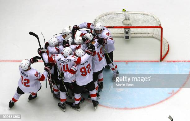 The team of Switzerland celebrate victory over Finland after the 2018 IIHF Ice Hockey World Championship Quarter Final game between Finland and...
