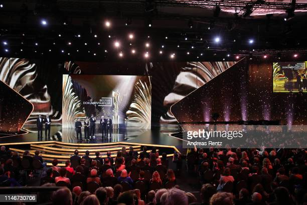 The team of the best documentary award winners are seen on stage during the Lola German Film Award show at Palais am Funkturm on May 03 2019 in...