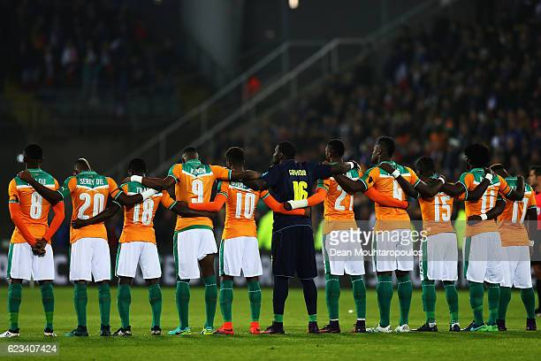 The team of The Ivory Coast stand for a minute silence prior to the International Friendly match between France and Ivory Coast held at Stade Felix...