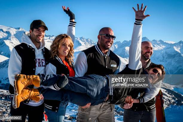 The team of the movie 'Nicky Larson et le parfum de Cupidon' poses following the screening of the film during the 22nd International Comedy Film...