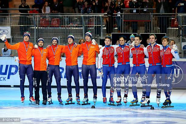 The team of the Netherlands poses during the medal ceremony after winning the 2nd place and the team of Russia poses during the medal ceremony after...
