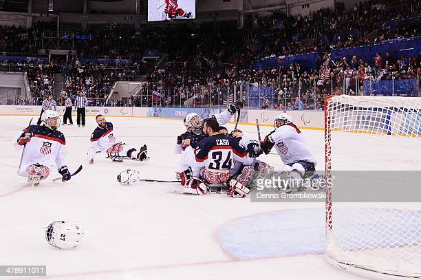 The team of the United States of America celebrates after the ice sledge hockey gold medal game between the Russian Federation and the United States...