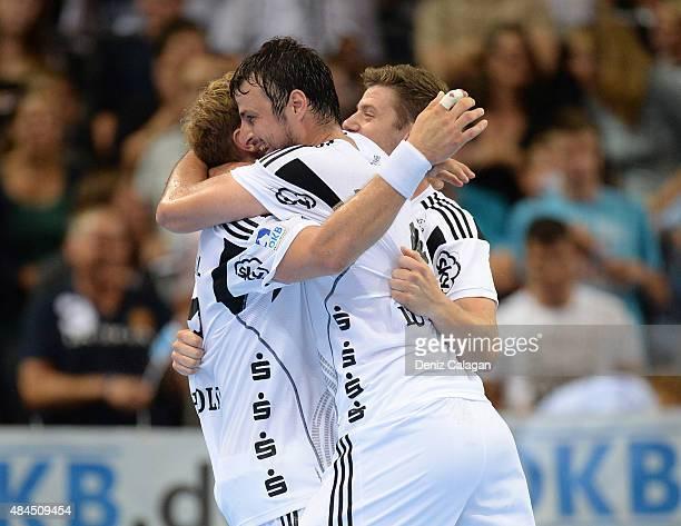 The team of THW Kiel celebrates the win after the Pixum Super Cup between THW Kiel and SG Flensburg Handewitt at PorscheArena on August 19 2015 in...
