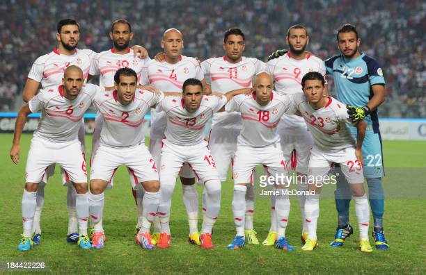 The team of Tunisia pose during the FIFA 2014 World Cup qualifier at the Stade Olympique de Radès on October 13 2013 in Rades Tunisia