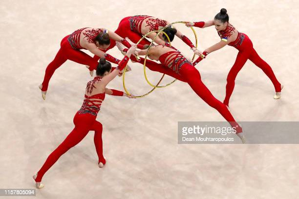 The team of Ukraine compete in the Rhythmic Gymnastics Women's Group Multiple Competition 3 hoops 4 clubs Final during the 2nd European Games held in...