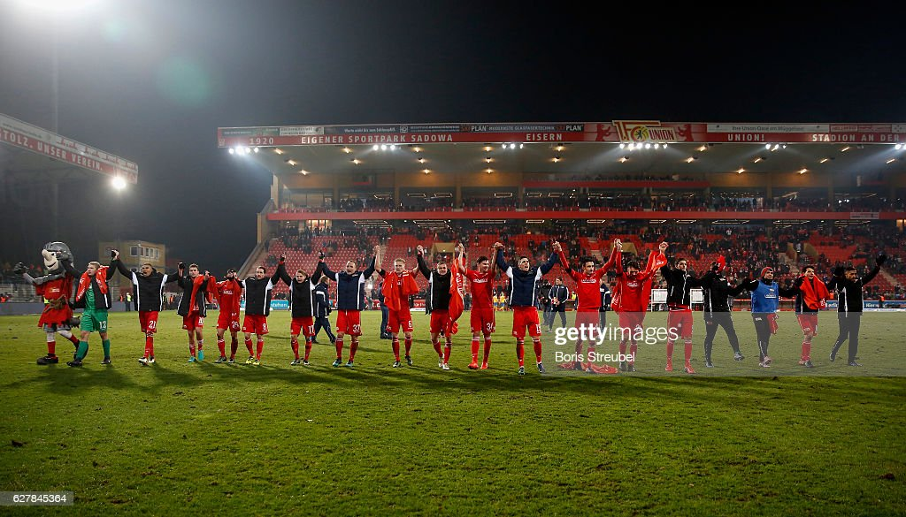 The team of Union Berlin celebrate after winning the Second Bundesliga match between 1. FC Union Berlin and Eintracht Braunschweig at Stadion An der Alten Foersterei on December 5, 2016 in Berlin, Germany.