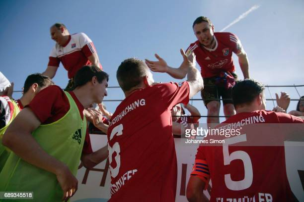 The team of Unterhaching celebrates with fans after the third league playoff leg one match at Alenbauer Sportpark on May 28 2017 in Unterhaching...