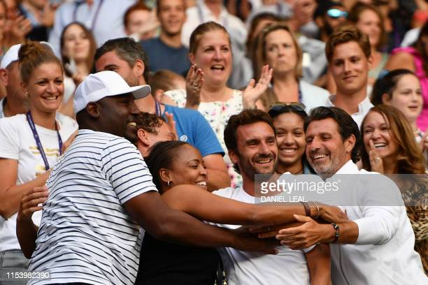 The team of US player Cori Gauff including her father Corey mother Candi French tennis coach JeanChristophe Faurel and tennis coach Patrick...