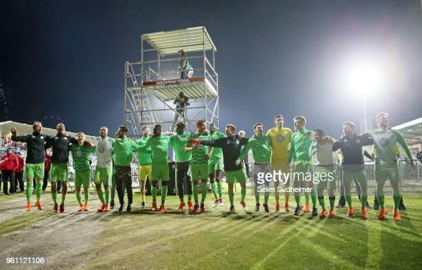 The team of VfL Wolfsburg celebrate their teams victory after the Bundesliga Playoff Leg 2 between Holstein Kiel and VfL Wolfsburg at HolsteinStadion...