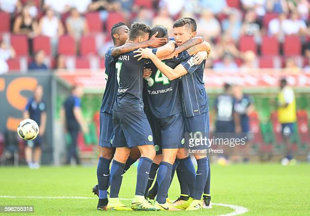 The team of VfL Wolfsburg celebrates it's second goal during the Bundesliga match between FC Augsburg and VfL Wolfsburg at WWK Arena on August 27...