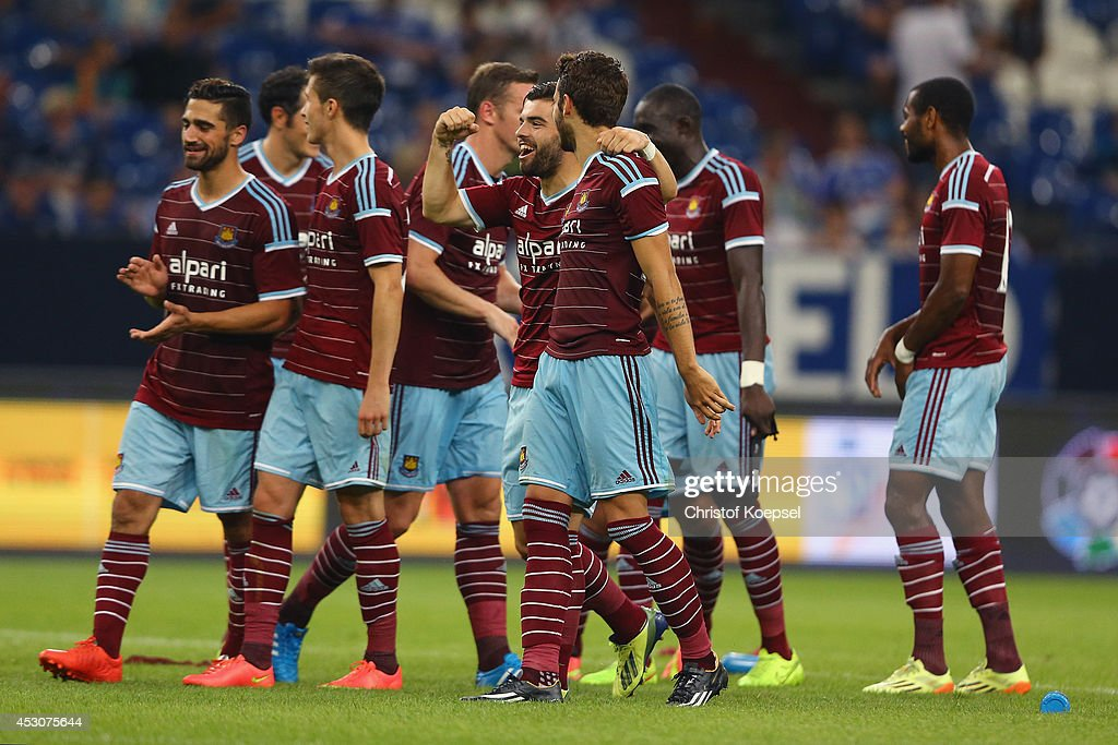 The team of West Ham United celebrates after the match between FC Schalke 04 and West Ham United as part of the Schalke 04 Cup Day at Veltins-Arena on August 2, 2014 in Gelsenkirchen, Germany. The match between Schalke and West Ham United ended 6-7 after penalty shoot-out.