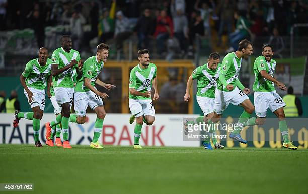 The team of Wolfsburg celebrate after the penalty shootout during the DFB Cup first round match between SV Darmstadt 98 and VfL Wolfsburg at Stadion...