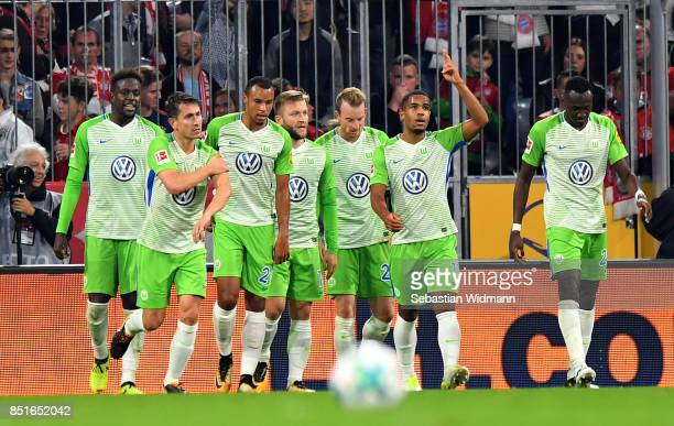 The team of Wolfsburg celebrate the equalizing goal during the Bundesliga match between FC Bayern Muenchen and VfL Wolfsburg at Allianz Arena on...