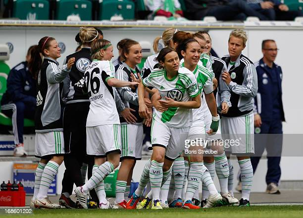 The team of Wolfsburg celebrate the first goal of Martina Mueller during the Women's Bundesliga match between VfL Wolfsburg and SC Bad Neuenahr at...