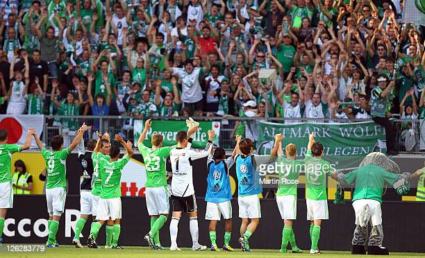 The team of Wolfsburg celebrate with the fans after the Bundesliga match between VfL Wolfsburg and 1 FC Kaiserslautern at the Volkswagen Arena on...