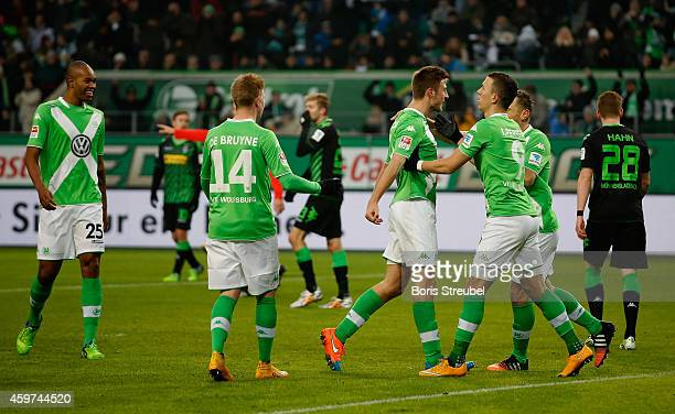 The team of Wolfsburg celebrates after Robin Knoche scores his team's first goal during the Bundesliga match between VfL Wolfsburg and Borussia...