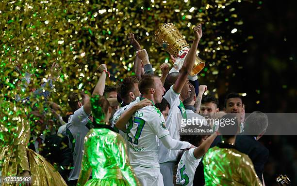 The team of Wolfsburg lift the trophy to celebrate after winning the DFB Cup Final match between Borussia Dortmund and VfL Wolfsburg at...
