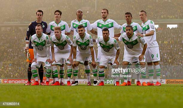 The team of Wolfsburg line up prior to the DFB Cup Final match between Borussia Dortmund and VfL Wolfsburg at Olympiastadion on May 30 2015 in Berlin...