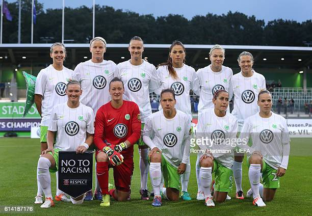 The team of Wolfsburg lines up holding a say no to racism pennant during the UEFA Women Champions League Round of 32 match between VFL Wolfsburg and...