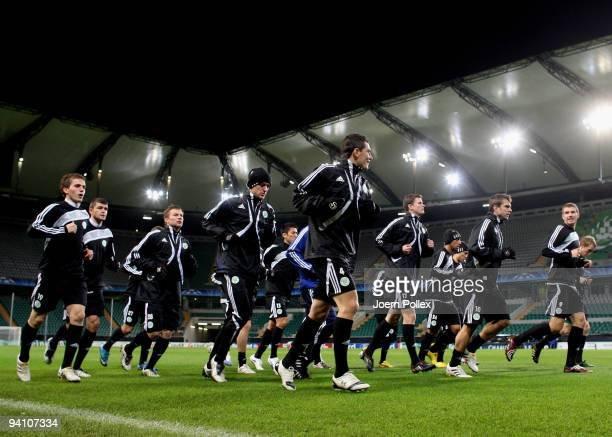The team of Wolfsburg warm up during a training session at the Volkswagen Arena on December 7 2009 in Wolfsburg Germany VfL Wolfsburg will face...