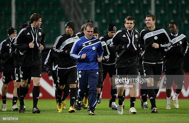 The team of Wolfsburg warm up during a training session at the Volkswagen Arena on December 7, 2009 in Wolfsburg, Germany. VfL Wolfsburg will face...