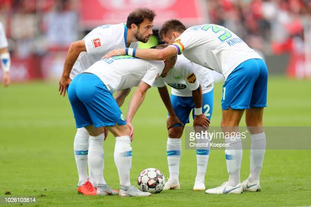 The team of Wolfsburg with Admir Mehmedi Maximilan Arnold William and Robin Knoche comes together during the Bundesliga match between Bayer 04...