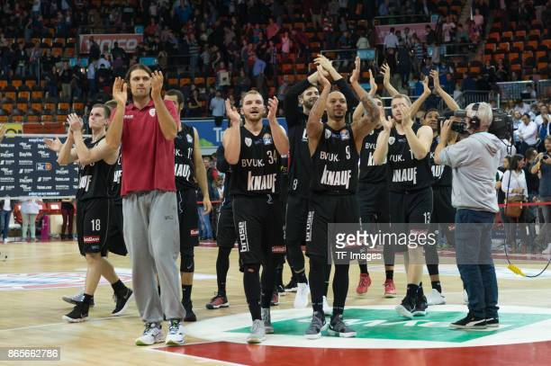 The team of Wuerzburg celebrates after winning the easyCredit BBL Basketball Bundesliga match between FC Bayern Muenchen and sOliver Wuerzburg at...