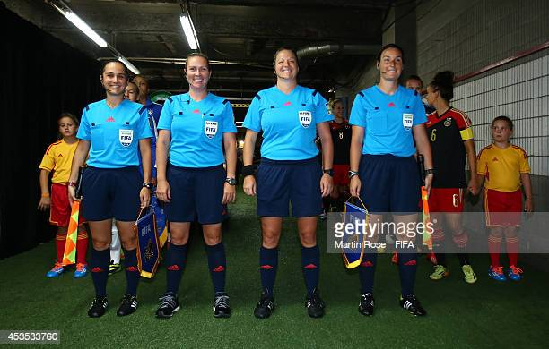 The team officials line up in the players tunnel before the FIFA U20 Women's World Cup 2014 group B match between Brazil and Germany at Olympic...