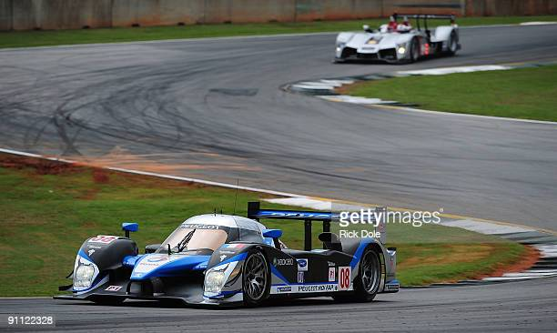 The Team Peugeot Total Peugeot 908 driven by Franck Montagny, Stephane Sarrazin, during practice for the American Le Mans Series Petit Le Mans at...