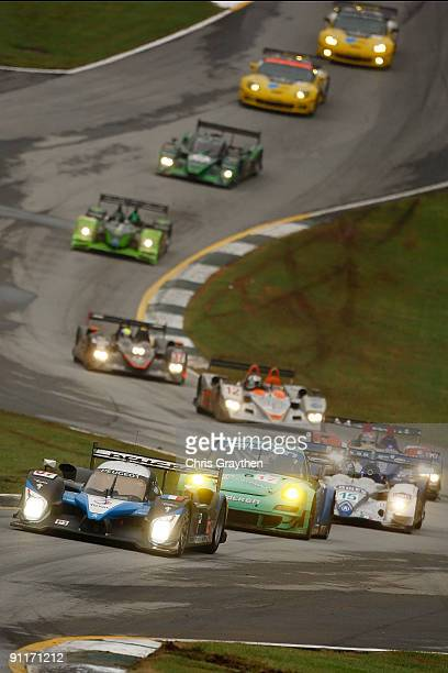 The Team Peugeot total Peugeot 908 HDI FAP driven by Nicolas Minassian and Pedro Lamy leads a group of cars under caution during the American Le Mans...