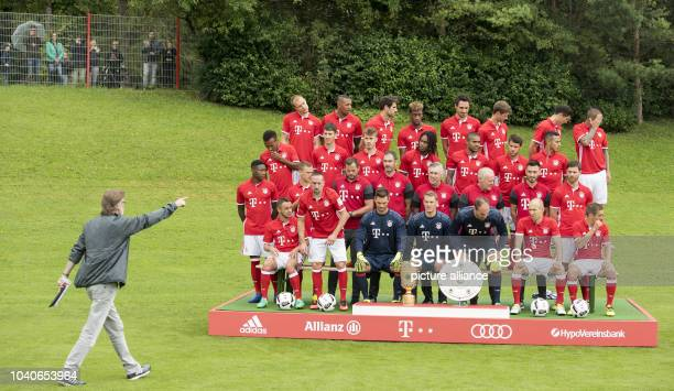 The team players of FC Bayern Munich Rafinha Franck Ribery Sven Ulreich Manuel Neuer Tom Starke Arjen Robben and Philipp Lahm Second row David Alaba...