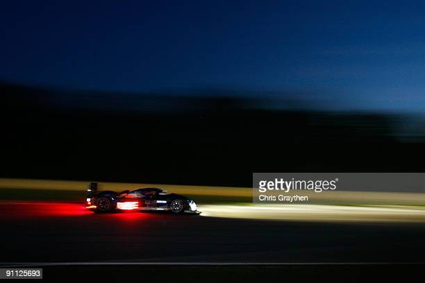 The Team Puegeot Total Peugeot 908 HDI FAP driven by Pedro Lamy drives during practice for the American Le Mans Series Petit Le Mans on September 24,...