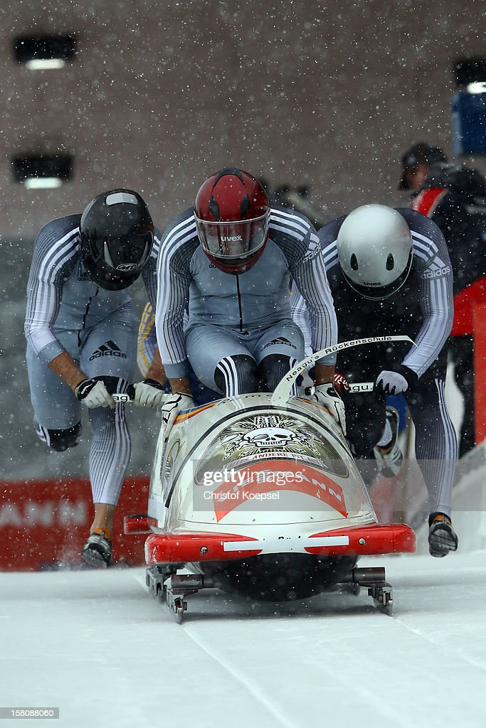 The team Roumania 1 with Andreas Neagu, Marian Iorga, Danut Stancu and Danut Moldovan sprints of during the four men's bob competition during the FIBT Bob & Skeleton World Cup at Bobbahn Winterberg on December 9, 2012 in Winterberg, Germany.
