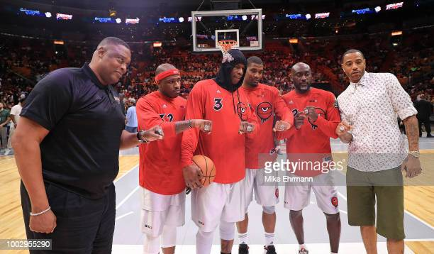 The team Trilogy displays their championship rings after they were presented to them in a ceremony before they played in a game during Big 3Week Five...